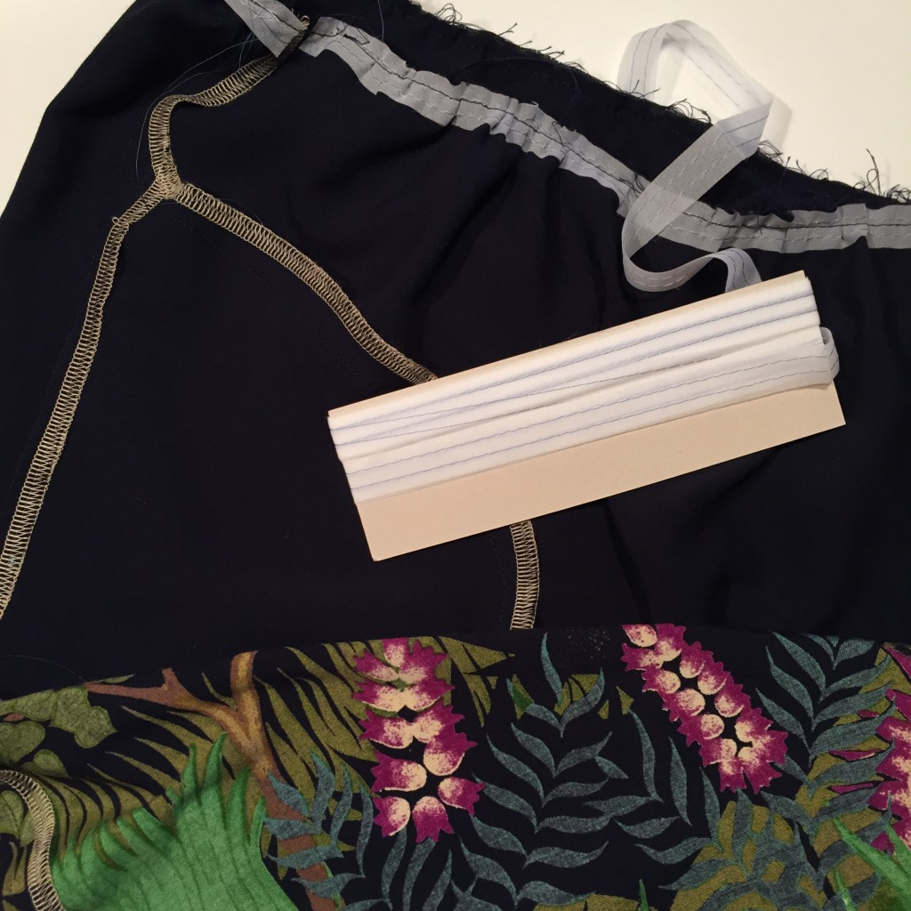 Using Fuse 'N Gather- Gathering Tape to attach the skirt to the bodice.