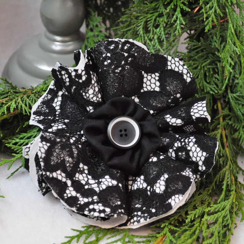 Finished knit fused lace fabric flower.