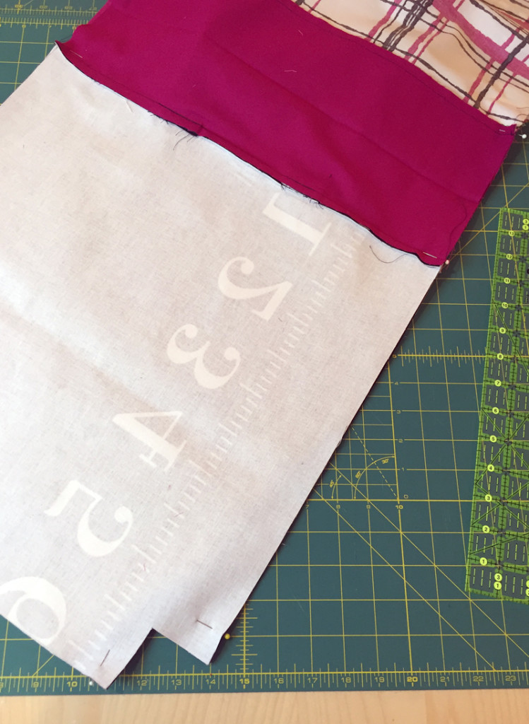 Sewing the two tote bag halves together.