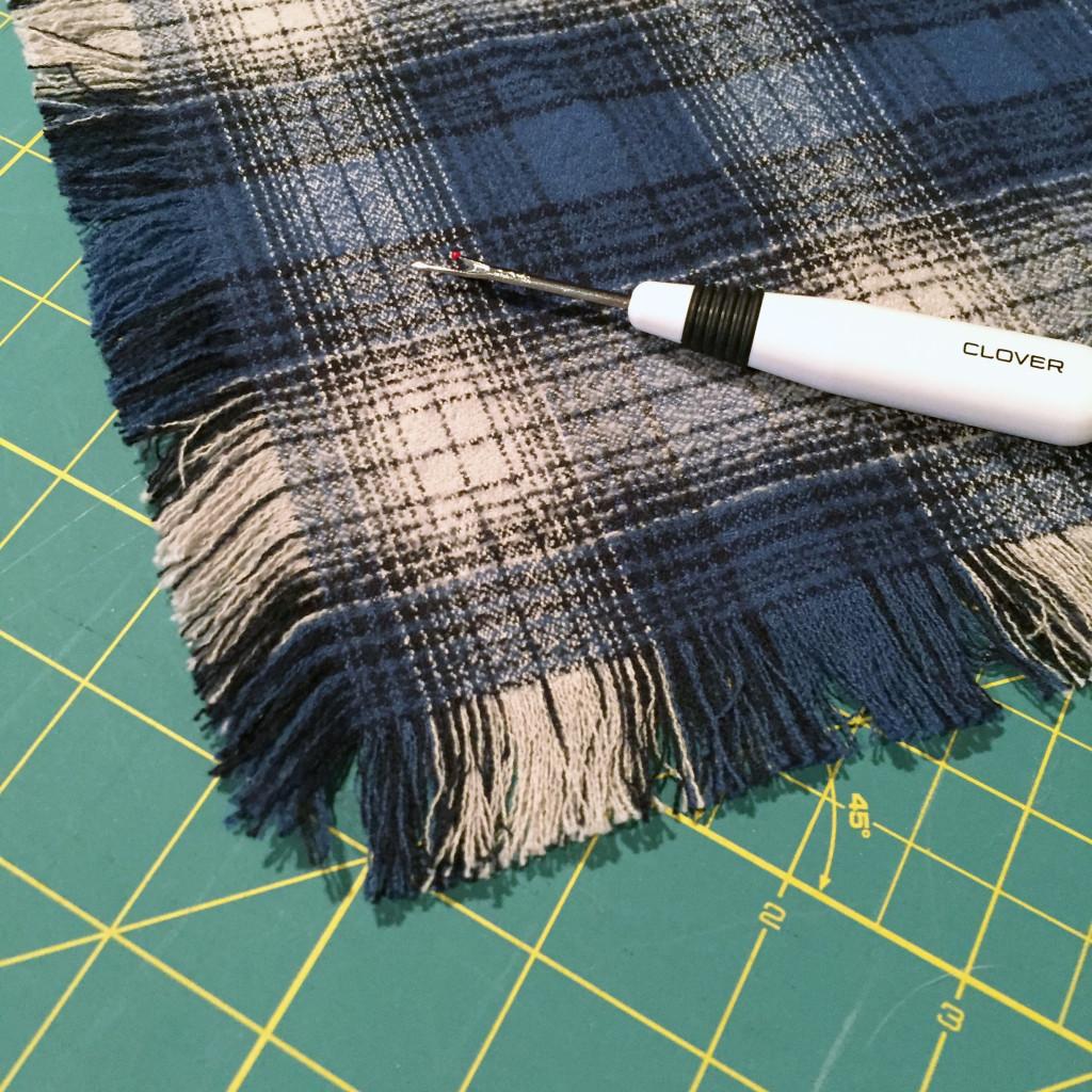 Close up of one corner on fringed scarf.