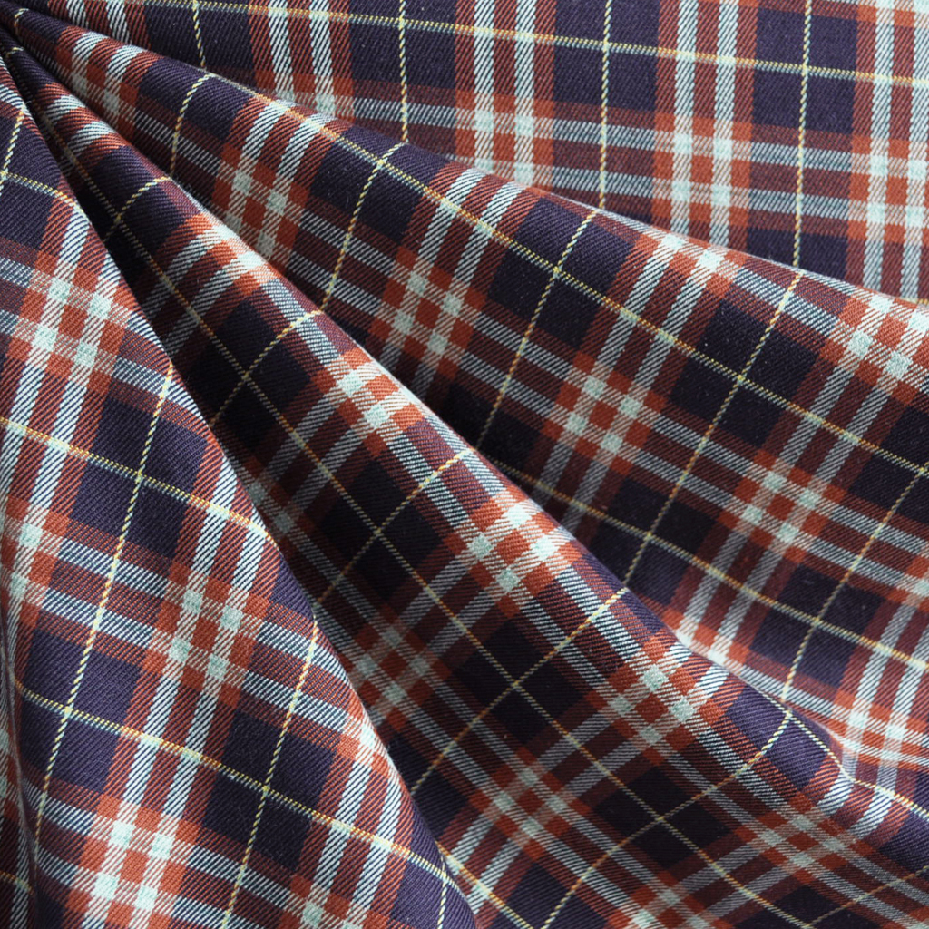Rayon plaid shirting in plum and rust.