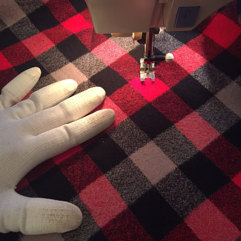 Using the plaid pattern as a guide for quilting.