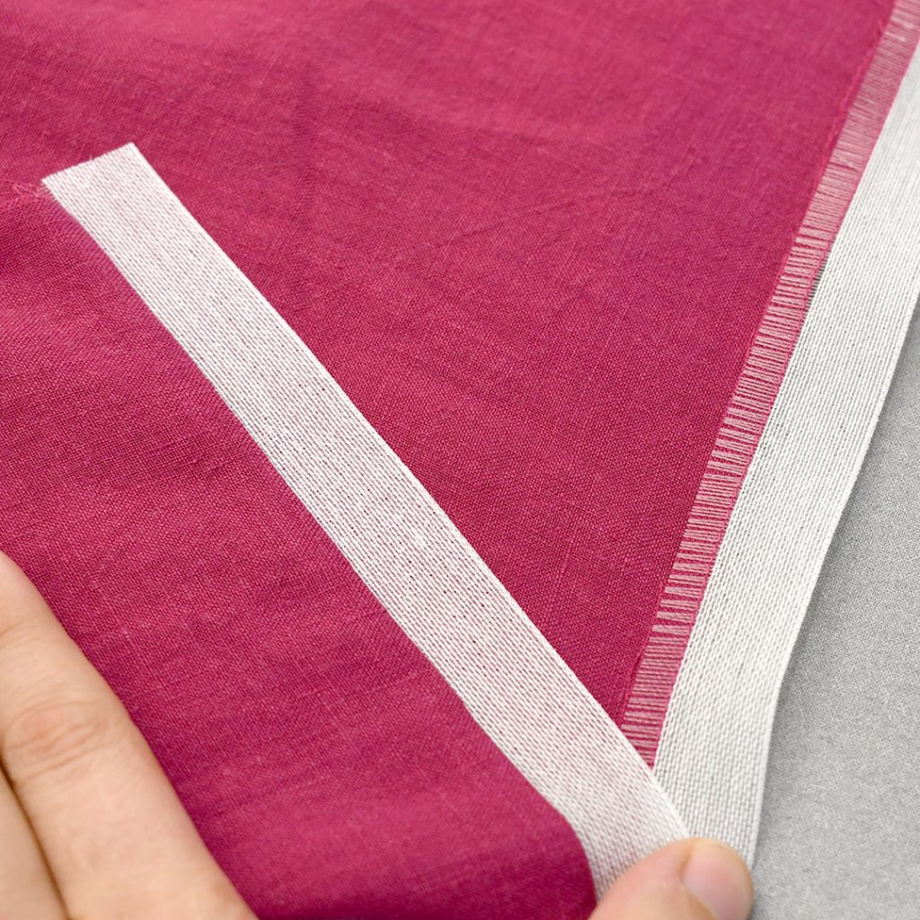 Ban-Roll pressed out creating the first hem fold | Style Maker Fabrics